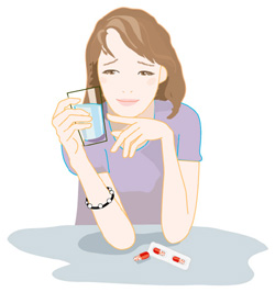 頭痛薬を飲む